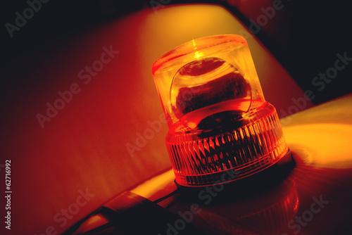 Fotografia Orange flashing and rotating light