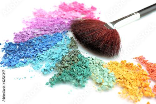 Rainbow crushed eyeshadow and professional make-up brush close Fototapeta