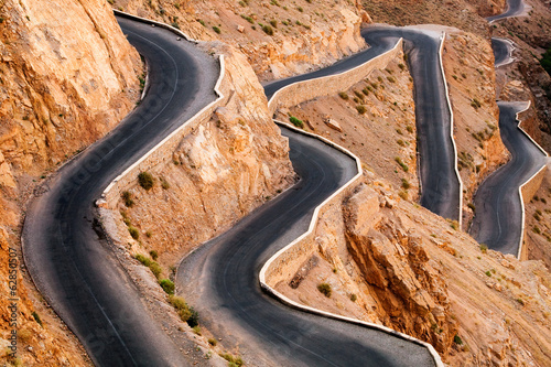 Very windy road up the rocky Atlas mountains from the Dades Valley, Morocco #62850507
