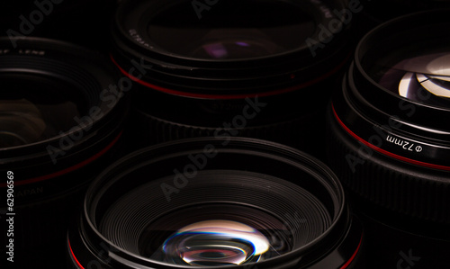 Fotografía Modern camera lenses with reflections, low key image