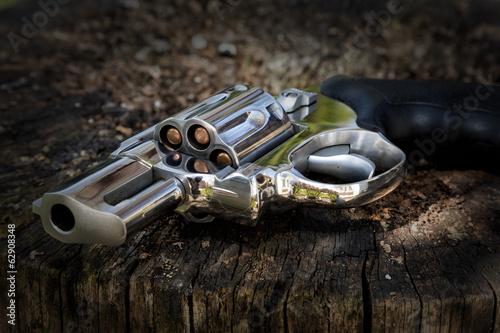Fototapeta Revolver thrown away