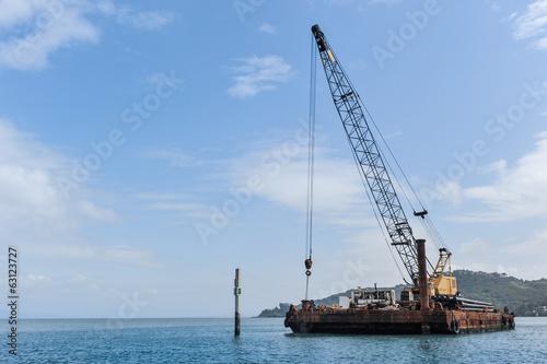 Slika na platnu Floating barge with a large crane