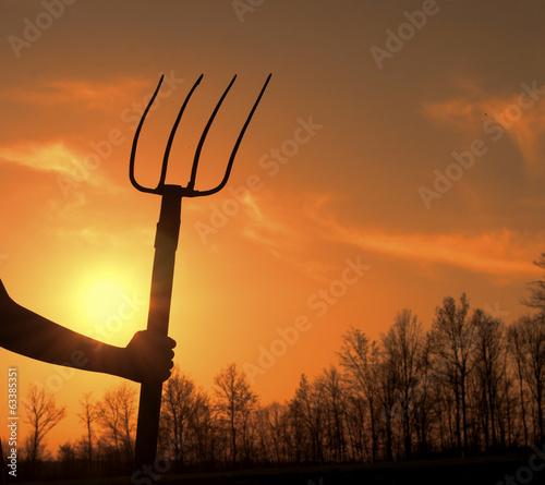 Fotografia, Obraz Woman holding hay fork