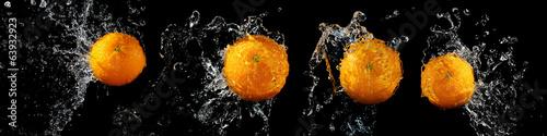 Set of fresh oranges in water splash