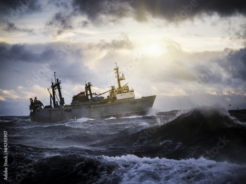 Canvas Print Fishing ship in strong storm.