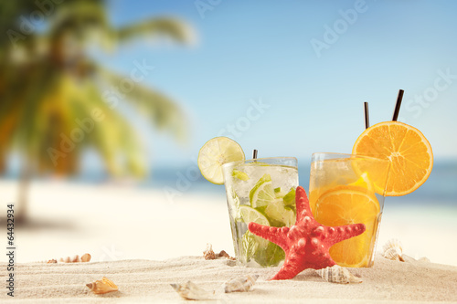 Summer beach with drinks and accessories