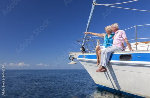 Canvas Print Happy Senior Couple Sailing on a Sail Boat