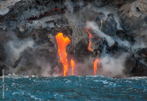Canvas Print Red hot lava flowing into Pacific Ocean on Big Island, Hawaii