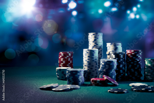 Leinwand Poster Casino chips with dramatic lighting and lens flares