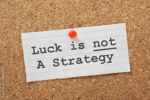 Luck is not a Strategy on a cork notice board as a reminder Fototapet