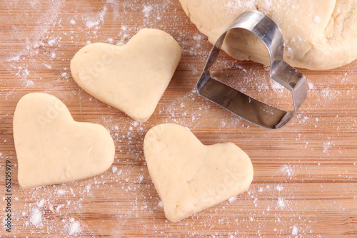 Making cookies on wooden background