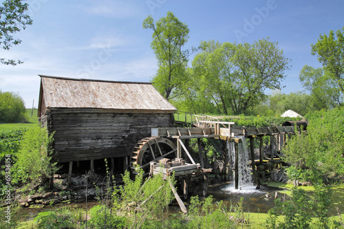 Carta da parati Wooden watermill in central Russia