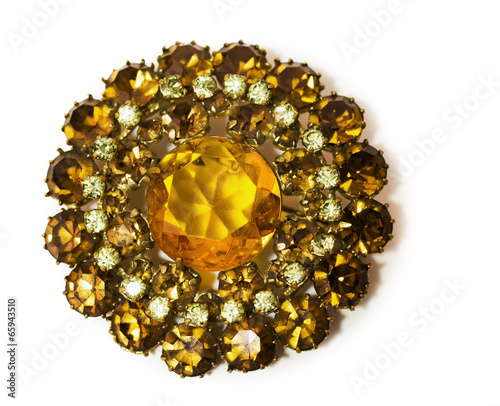 Canvas vintage golden brooch with gems in the shape of a flower