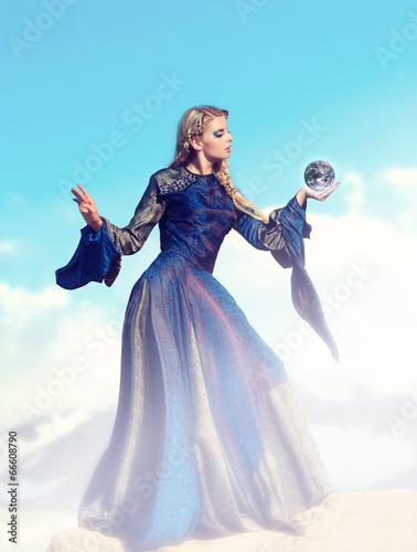 Fotografia Fairy-tale – the sorceress with magic sphere