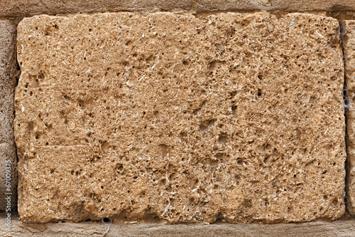 Photo block of tuff on wall of medieval palace