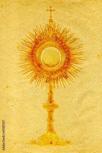 liturgical vessel gold monstrance on grunge paper background