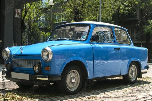Wallpaper Mural Blue vintage restored Trabant car on paved street