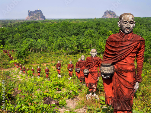 Stampa su Tela Statues of Buddhist Monks in the Forest, Mawlamyine, Myanmar