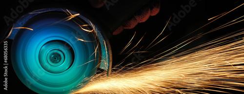 Fotografia, Obraz Worker cutting metal with grinder