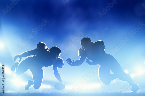 Canvas Print American football players in game, touchdown. Stadium lights