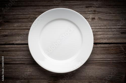 Fototapeta Empty white plate on wooden table
