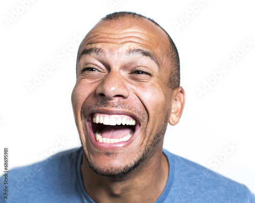 Fototapeta Portrait of a mixed race man laughing hysterically