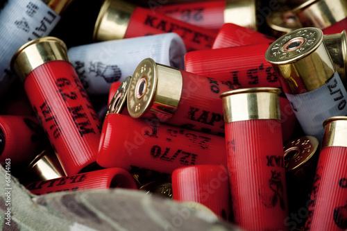 Obraz na płótnie Rebels shotgun cartridges in multicam cap