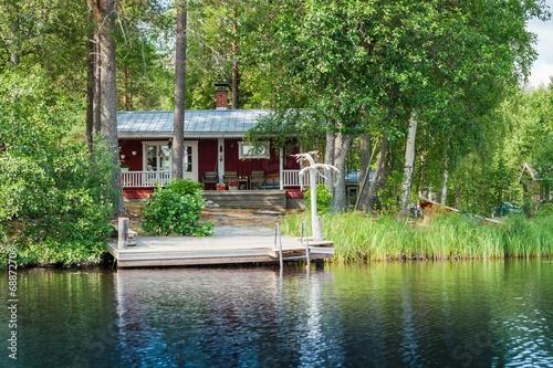 Fototapeta Old Finnish summer cottage at a lake