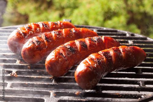 Canvas Print Grilling sausages.
