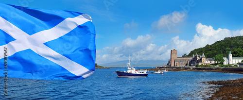 Fotografie, Obraz Scottish flag on Oban bay background