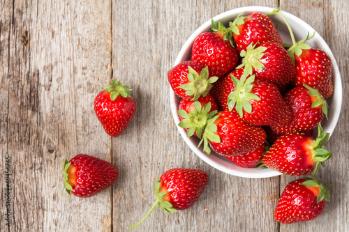 Red strawberry in a bowl