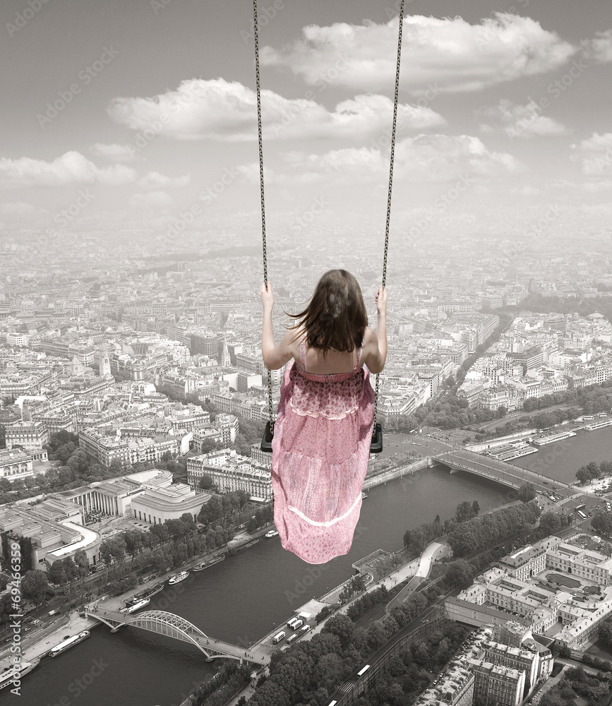 Young woman on a swing on the Paris town backround. Surrealism c - obrazy, fototapety, plakaty