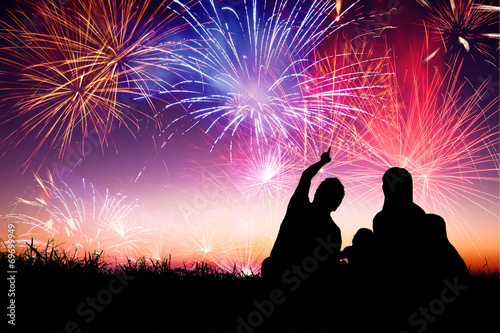 Canvas Print happy family sitting on floor and watching the fireworks