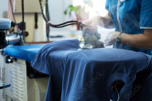 Obraz na plátně Image of laundry worker at work