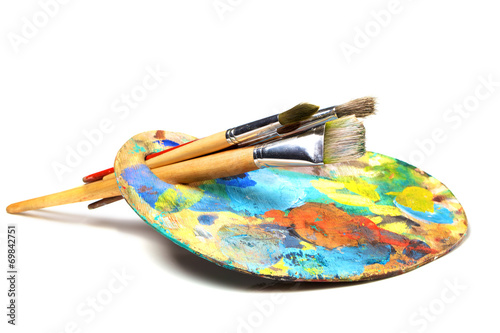 Canvas Print Art palette with paint and a brush on white background