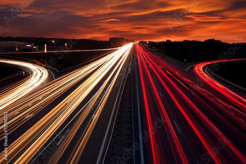 Fotografia Speed Traffic - light trails on motorway highway at night