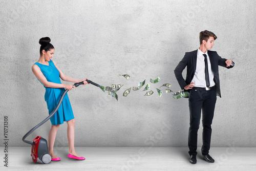 Woman vacuuming money out of man's pocket Fototapeta