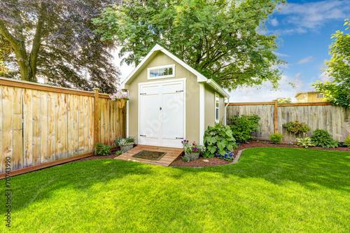 Cuadros en Lienzo Fenced backyard with small shed