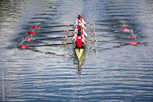 Canvas Print Eight men rowing