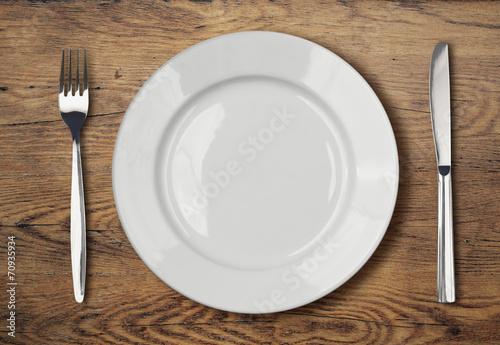 Wallpaper Mural white empty dinner plate setting on wooden table