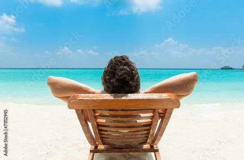 Stampa su Tela Man relaxing on beach
