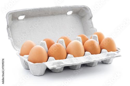 Ten brown eggs in a carton package