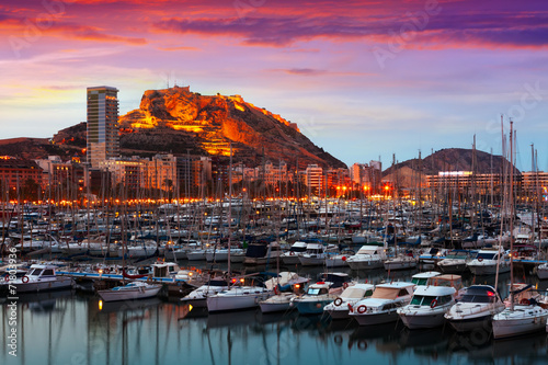 Leinwand Poster port  and Castle of Santa Barbara during sunset. Alicante