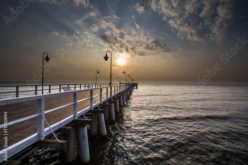 Sunrise on the pier at the seaside, Gdynia Orlowo,  #71900994