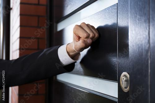 Leinwand Poster Hand an die Tür klopft