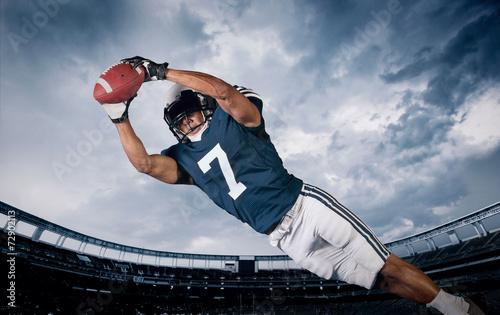 Canvas Print American Football Player Catching a touchdown Pass