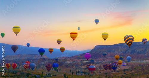 Obraz na plátne Hot air balloons sunset