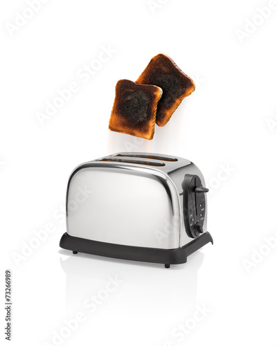 Burnt bread pops out from toaster.