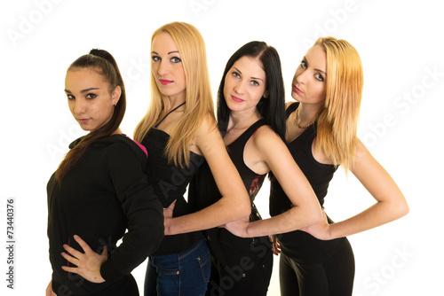 Murais de parede Quatre jeunes femmes heureuse isolé sur fond blanc