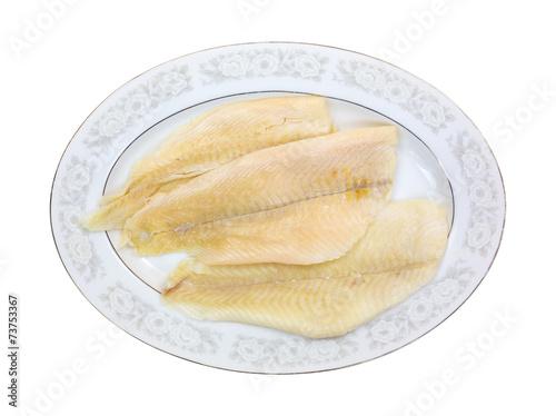 Fototapeta Fresh flounder fillets on oval platter